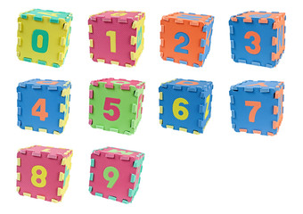 Toy cubes with the number zero to nine isolated on white