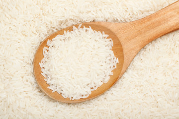 Thai fragrant jasmine rice with wooden spoon