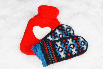 Wool gloves and hot water bottle