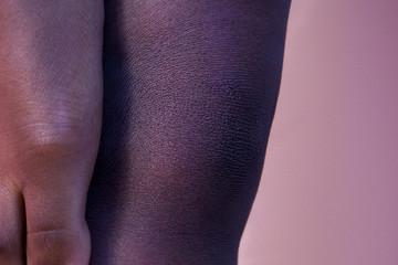 Closeup shot of woman 's leg and foot in yoga tree pose