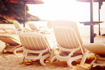 Row of beach chairs on the sea