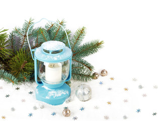 Snowy blue lantern and Christmas balls on the background of fir