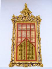 Thai ancient window frame stucco.