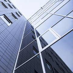 facade of office building and reflections of sky