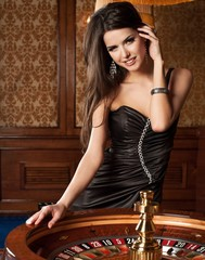Girl playing in casino.