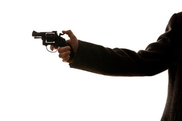 man shooting a handgun