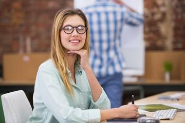 Female photo editor using digitizer in office