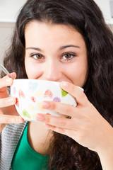 Teen girl having breakfast
