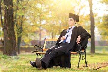 College graduate enjoying in park
