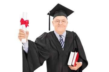 Mature man holding a college diploma