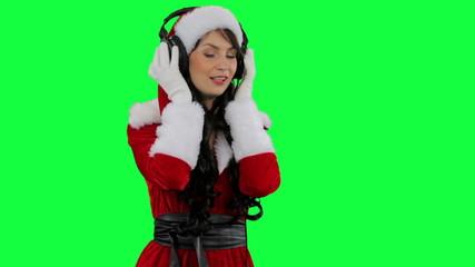 Santa helper girl putting on headphones
