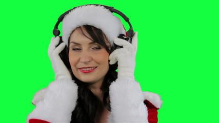 Santa helper girl putting on headphones closeup