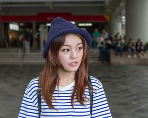 Asian woman outside subway station