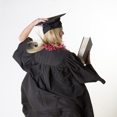 Mature female student wearing cap and gown