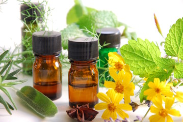 essential oils with herbs and flower