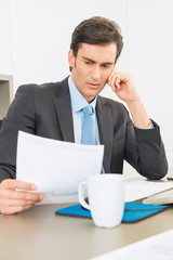 Serious Businessman reading a report