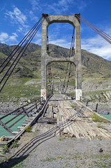 Abandoned bridge over the river Katun, Altai, Russia