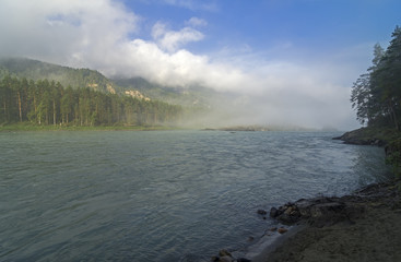 Morning fog over the river. Altai mountains, Russia.