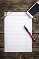 Blank note paper with pen on table
