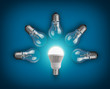 Idea concept with light bulbs and glowing led bulb