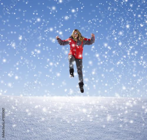 canvas print picture Frau mit Rotem Anorak im Schnee