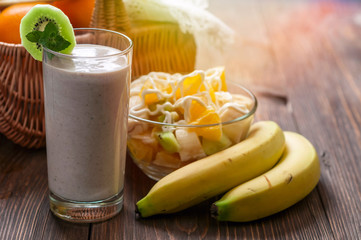 Banana smoothie with fruit salad and two bananas