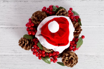 Santa claus red hat. On white wood background