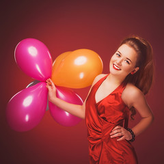 Brunette in a red dress. Vintage. Balloons
