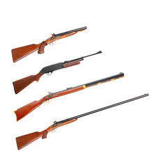 Collection of hunting rifles on white background.
