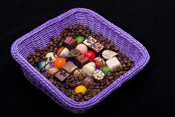 chocolate pralines and coffee beans in lavender basket