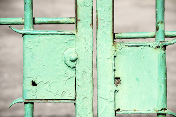 Obsolete light green painted locks of metal patio doors