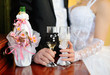 bride and groom holding beautifully decorated wedding glasses wi