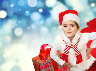 Little santa girl with presents. Christmas background.