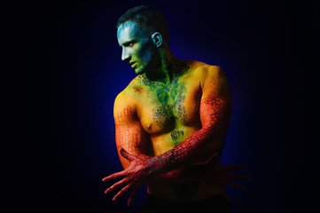 Muscle man with fantasy body art