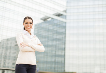 Young business woman in front of office building