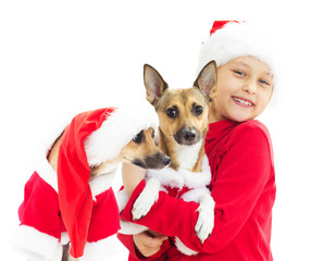 girl in Christmas clothes holding hands on a red dog on a white