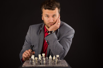 men play chess on a black background