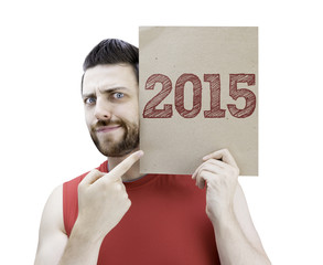 Man holding a card with the text 2015