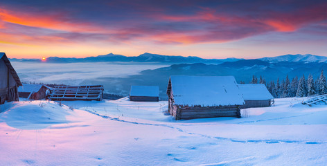 Colorful winter panorama of the Carpathian mountains at sunrise