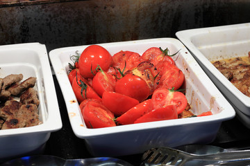 Plate with grilled tomatoes