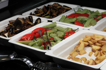 Tray with grilled vegetables and fried potatoes