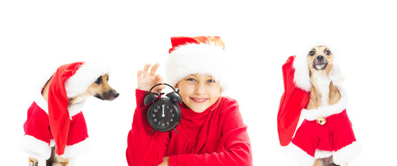little girl in Santa Claus hat holding alarm clock showing twelv