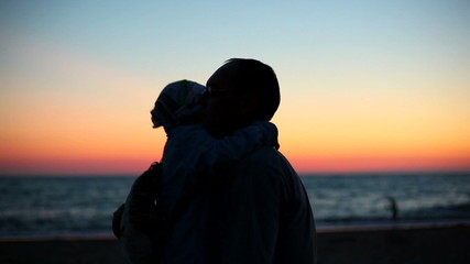father and son at sunset 2