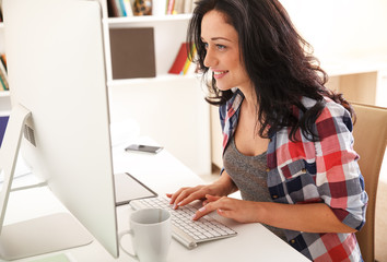Attractive female working at home.Blogging.