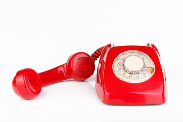 Red telephone on white background.