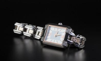 photo luxury woman's watch on black