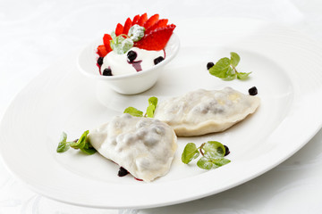 blueberry dumplings with sauce