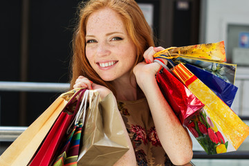 Attractive happy girl out shopping