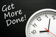The phrase Get More Done on a blackboard with a clock - 73062896