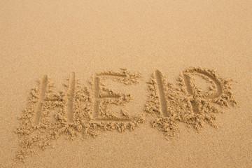 Help - Inscription on the sand of tropical beach